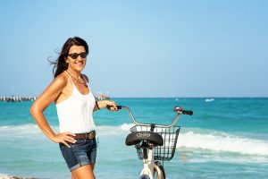 Brenda at the beach with bike